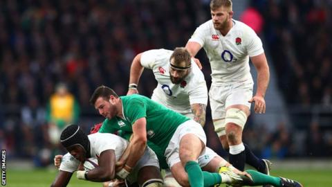 Maro Itoje of England is tackled by Robbie Henshaw of Ireland during the RBS Six Nations match between England and Ireland at Twickenham Stadium on February 27, 2016 in London, England.