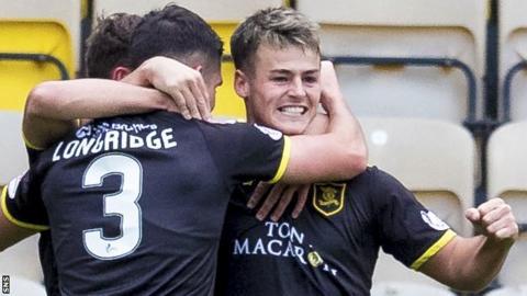 Livingston striker Danny Mullen (right) celebrates