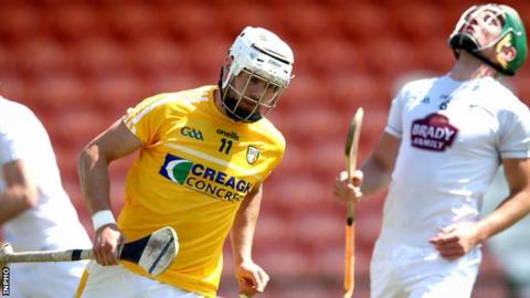 Antrim's Neil McManus celebrates his first goal at the Athletic Grounds