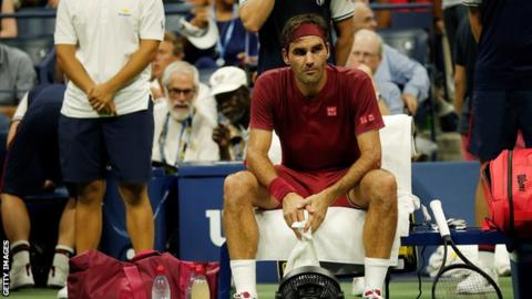 Roger Federer looks glum as he sits courtside at the US Open