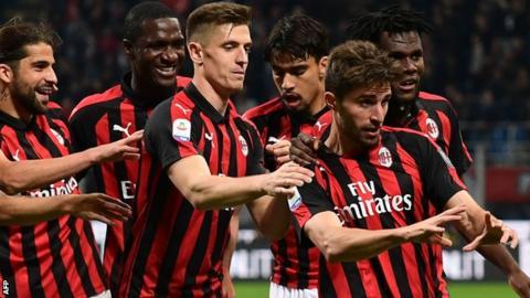 Fabio Borini celebrates his goal for AC Milan