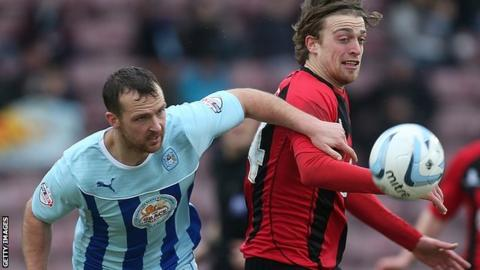 Andy Webster (left) in action for Coventry City