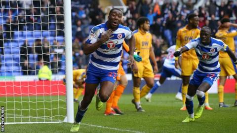 Yakou Meite of Reading celebrates his injury-time winner against Wigan
