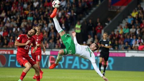 Kyle Lafferty with an acrobatic effort during the Group C World Cup qualifier