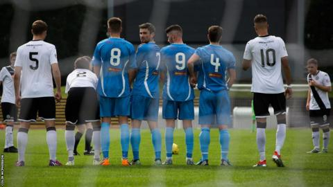 Edinburgh City striker Ross Allum lines up a free-kick against Berwick Rangers
