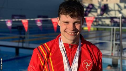 Alex Bregazzi wears some of the medals that he has won at the Island Games