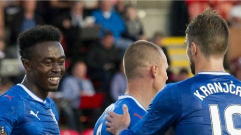 Rangers players celebrate a goal in their win against East Stirlingshire