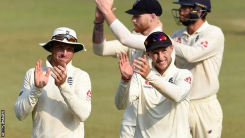 England's Jos Buttler (left) and Joe Root (right) applaud the fans as they walk from the field following third Test victory over Sri Lanka