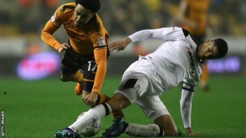 Derby County's Curtis Davies slides in against Wolves winger Helder Costa