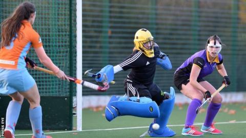 Alana Doyle of Ards forces a save from Pembroke Wanderers goalkeeper Tiffaney Ellis