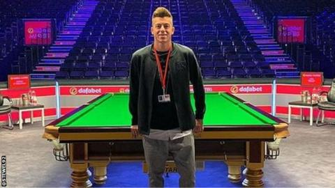 Stephan El Shaarawy stands by the table at Alexandra Palace