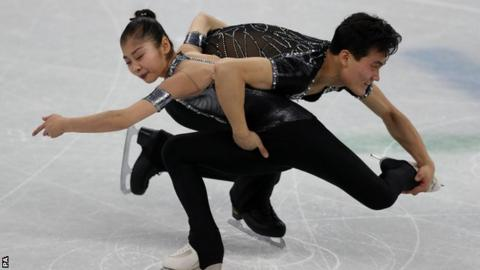 Here are a pair of North Korean figure skaters who belong
