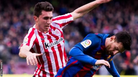 Aymeric Laporte challenges Lionel Messi