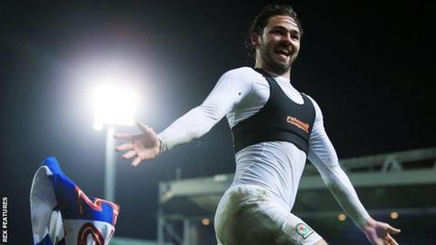 Bradley Dack throws off his shirt after scoring Blackburn's third goal against Peterborough