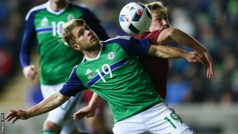 Jamie Ward and Aleksejs Visnakous battle for possession at Windsor Park