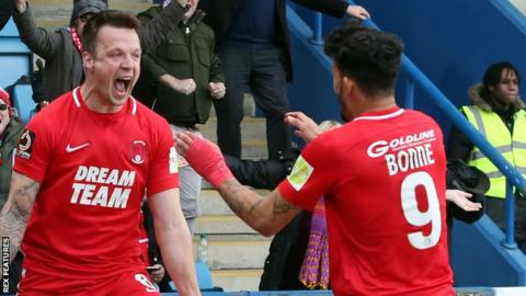 Josh Coulson (left) celebrates after scoring for Leyton Orient in their win against AFC Telford United