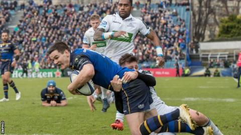 Leinster fly-half Johnny Sexton crosses for his side's fifth try against Glasgow