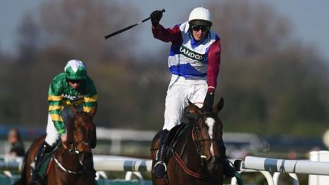 Jockey Derek Fox rides One for Arthur (C) to win the Grand National