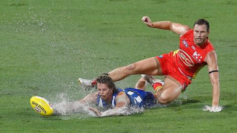 Jed Anderson of the Melbourne Kangaroos and Sam Day of the Gold Coast Suns
