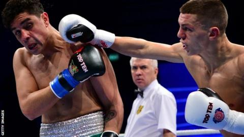 Pat McCormack throws a punch at Raul Curiel
