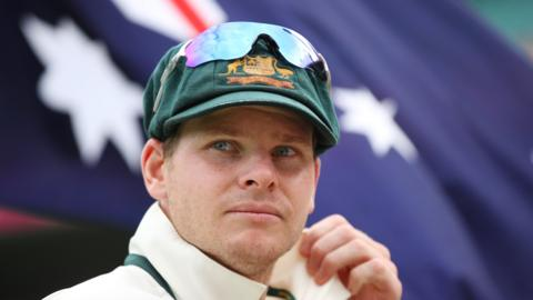 Steve Smith in front of the Australia flag