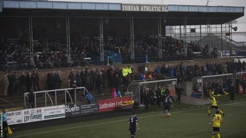 Spectators in a crowd of 446 watch the first half action as Edinburgh City look for their second successive away win