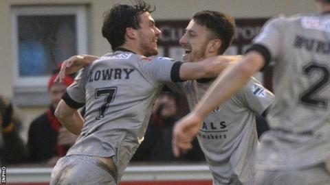 Philip Lowry rushes in to congratulate Crues scorer Jordan Forsythe in the league win over Ballinamallard