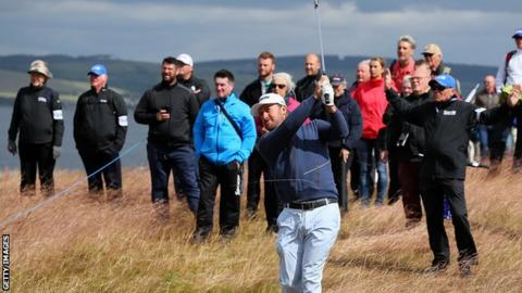 Graeme McDowell plays his second shot at the 18th in the opening round of the Scottish Open