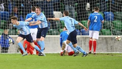 Paddy McNally turns away in delight after heading Ballymena into a first-half lead
