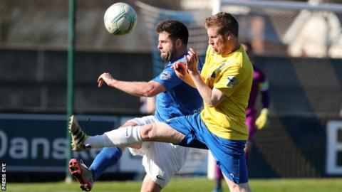 Darren Henderson (right) battles with Glenavon's Simon Kelly last month