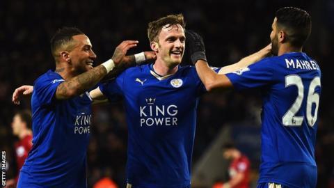 Andy King (centre) celebrates a goal with Danny Simpson and Riyad Mahrez