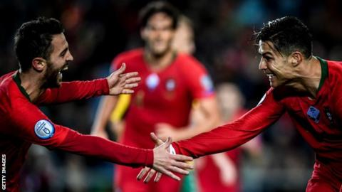 Ronaldo on 99 goals as holders Portugal seal Euro berth