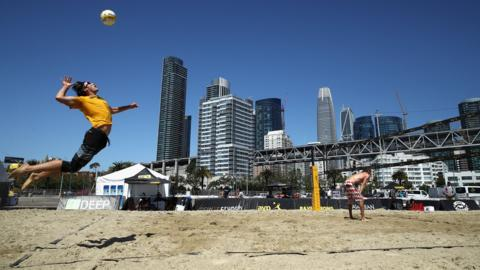 SAN FRANCISCO, CA - JULY 05: Tom Kohler serves, as his partner Tony Pray looks on, during their match against Michael Boag and Skylar del Sol during Day 1 of the AVP San Francisco Open at Pier 30-32 on July 5, 2018 in San Francisco, California. (Photo by Ezra Shaw/Getty Images)