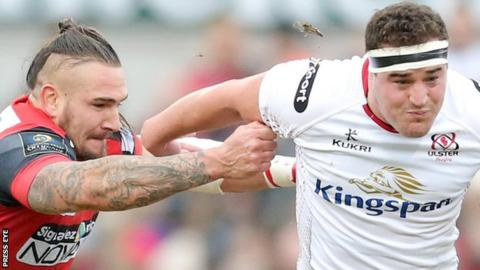 Pierrick Gunther of Oyonnax attempts to stop Ulster's Rob Herring