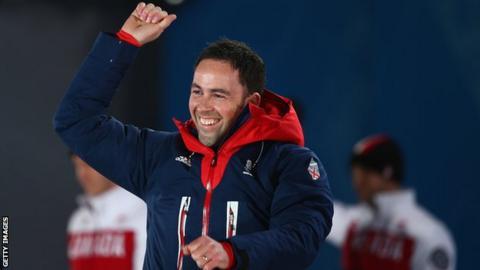 David Murdoch enjoys the medal ceremony at the Sochi Games in 2014