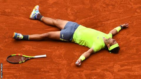 Nadal lies on the ground in celebration