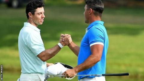 Rory McIlroy shakes the hand of playing partner Brooks Koepka on the final day of the World Golf Championships Invitational in Memphis, United States