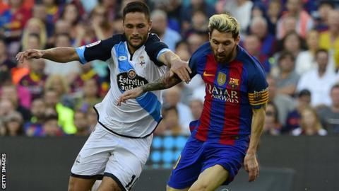 Florin Andone tackles Lionel Messi