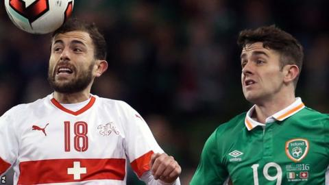 Switzerland's Admir Mehmedi competes with Robbie Brady of the Republic of Ireland