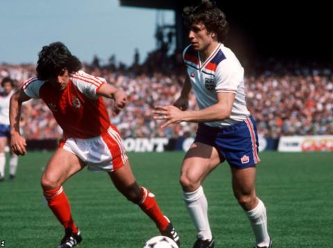Wales beat England 4-1 with David Giles, seen here in action against Kenny Sansom, among the goalscorers.
