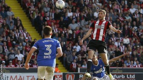 Chris Basham heads Sheffield United ahead against Ipswich