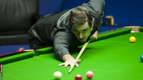 Ronnie O'Sullivan taking a shot