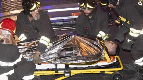 A person injured after the collapse of the escalator in the Repubblica metro station in Rome 23 October 2018, is taken away by emergency personnel