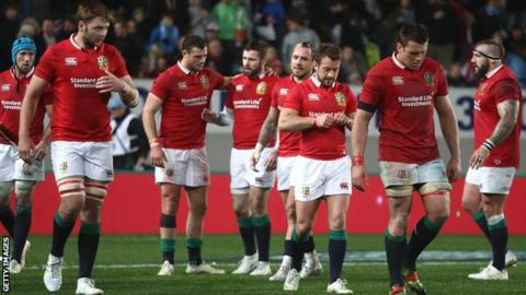 The dejected Lions troop off