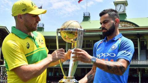 aaron finch and virat kohli australia captain aaron finch and india counterpart virat kohli with the world cup trophy