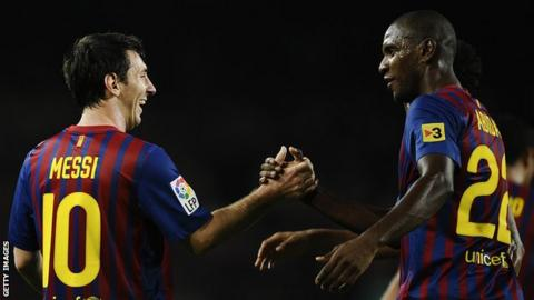 Lionel Messi and Eric Abidal