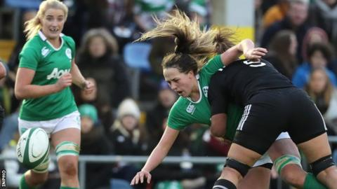 Ireland's Nichola Fryday spills the ball after this heavy challenge from Charlene Gibb of New Zealand