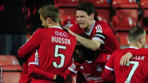 Wrexham players celebrate against Kidderminster Harriers