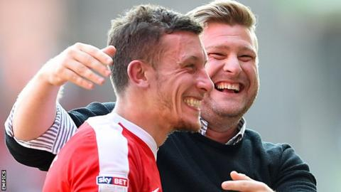 Charlton centre-back Jason Pearce with manager Karl Robinson