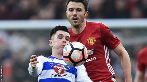 Reading's Liam Kelly shields the ball from Manchester United midfielder Michael Carrick in January's FA Cup tie